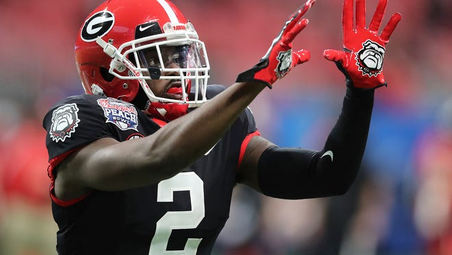 Georgia safety Richard LeCounte, who was injured in a motorcycle accident last season, was chosen by the Browns in the fifth round, No. 169 overall. [Curtis Compton/Atlanta Journal-Constitution via AP]