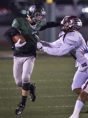 Dinuba's Nathan Carrion tries to evade Independence's