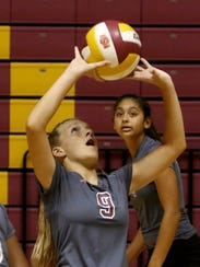 Vernon's Taylor Reeves sets the ball up in the match