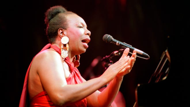 The late jazz and blues singer Nina Simone, shown in concert in 1991 at the Olympia music hall in Paris. She died at 70 in 2003.