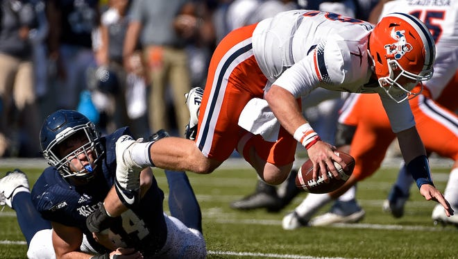 UTEP quarterback Ryan Metz, right, is sacked by Rice defensive end Brian Womac (44) during the first half of an NCAA college football game, Saturday, Nov. 19, 2016, in Houston.