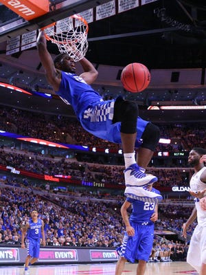 Kentucky Wildcats forward Alex Poythress (22) dunks during the second half against the Duke Blue Devils at the United Center. Kentucky won 74-63.