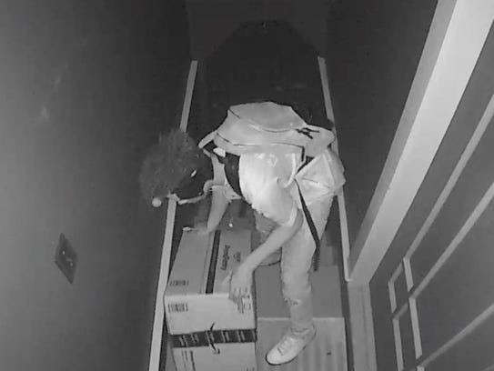 A screen shot from a video uploaded to the neighborhood web site Nextdoor in San Francisco. The homeowner whose camera it came from said that on Oct. 21 at 8:53 pm the young man came up the stairs to his door, lifted the package to see how heavy it was and then left and came back with a pair of scissors, presumably to open it. But instead he simply picked up the entire package and walked away with it. The video was made available to local police but the alleged thief was not identified.