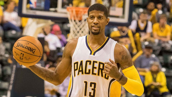 Indiana Pacers forward Paul George (13) dribbles the ball in the second half of the game against the New Orleans Pelicans at Bankers Life Fieldhouse. The New Orleans Pelicans beat the Indiana Pacers by the score of 110-105.