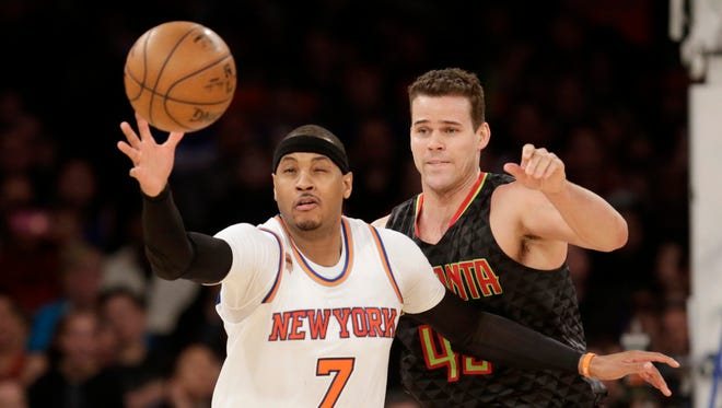 The Atlanta Hawks' Kris Humphries, right, defends the Knicks' Carmelo Anthony during Monday's game. The Hawks defeated the Knicks 108-107.