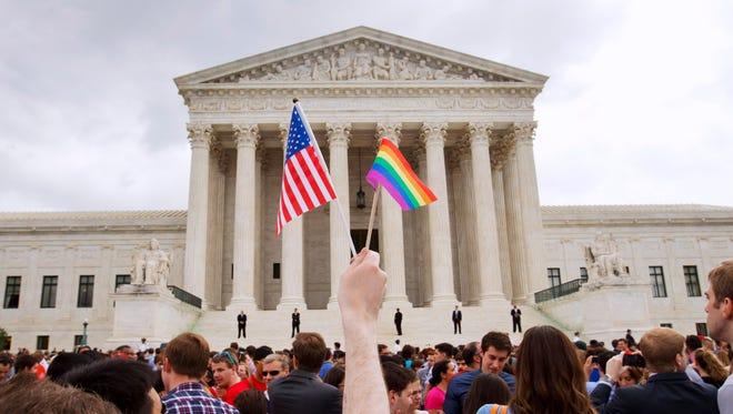 The crowd celebrates outside of the Supreme Court on Friday June 26, 2015, after the high court declared that same-sex couples have a right to marry anywhere in the US.
