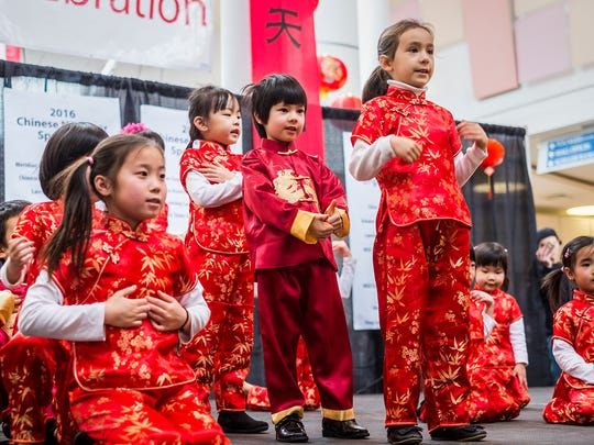 Kids from the MSU Chinese School perform a dance at the Greater Lansing Area Chinese New Year Celebrations Sunday, February 7, 2016.