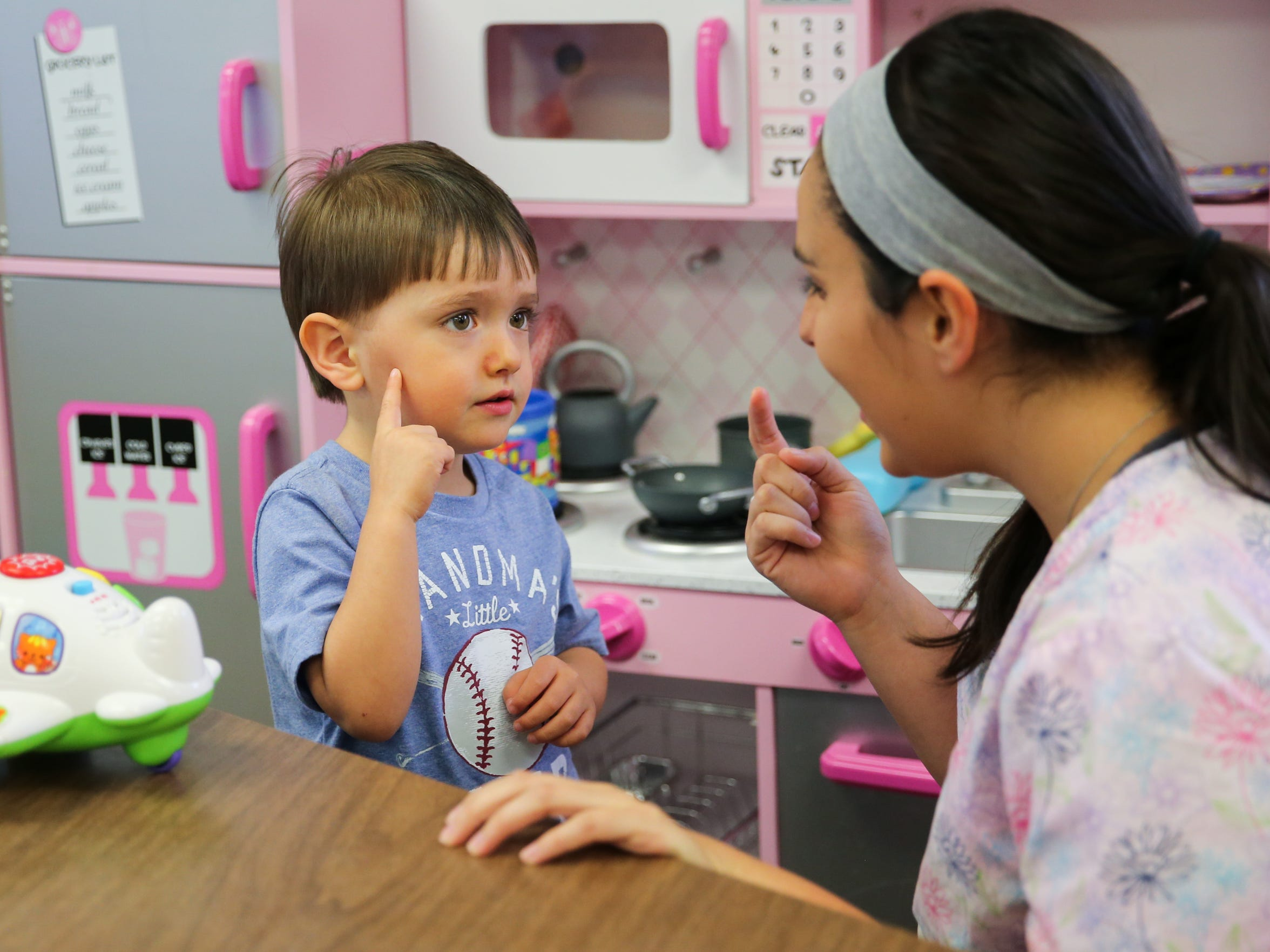 Mykaela Lara, registered behavior technician, works with Aiden Lopez, 3, on the sign for candy during ABA Therapy at ABC Autism Center for Children through MHMR Services for the Concho Valley.