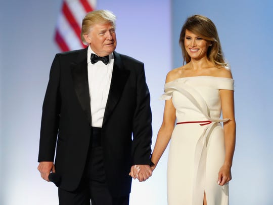 Melania Trump models the dress as she and President