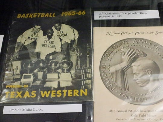 A 1965-66 media guide at left is among the items on