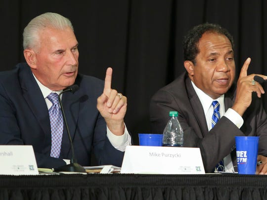 Candidate Mike Purzycki (left) and former Mayor Dennis Williams disagree during a debate a 2016 Democratic Wilmington mayoral debate.