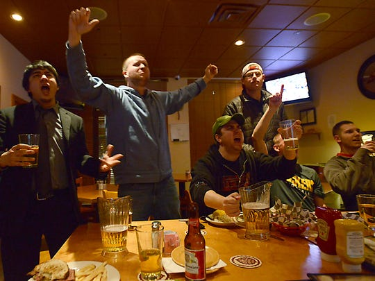 Alabama fans from left, Jarrod Pargas, Ryan Popplewell, Adam Grabish, Shamy Reichert, Brad Brannon, and Brock Beidleman, cheer a touch down as they watch the BCS National Championship game at Pappy's Corner Pub in Fort Collins Monday Jan. 7, 2013, in which the University of Alabama played Norte Dame University.