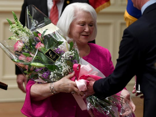 Jane Alderson receives flowers after being named the