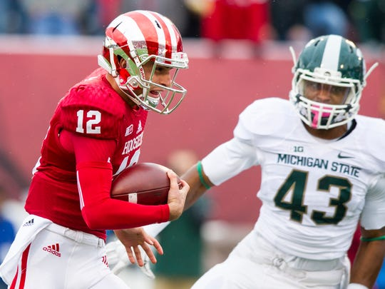 Indiana QB Zander Diamont (12) rushes the ball into the Michigan State defense on the first play from scrimmage during the first half of action, Oct. 18, 2014.