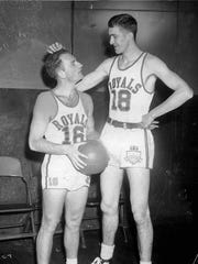 Arnie Risen, right, towers over teammate Red Holzman in this 1948 photo.