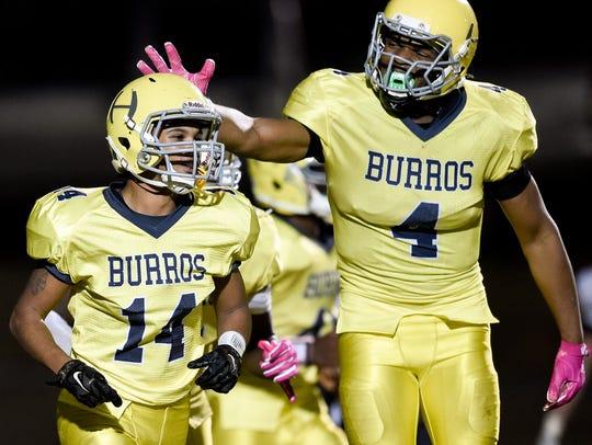 Hillsboro defensive back Berry Johnson (14) and defensive