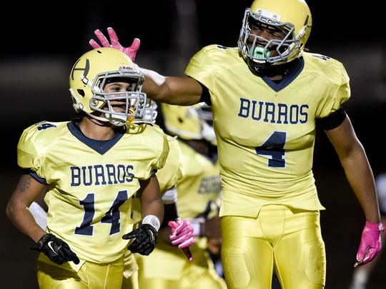Hillsboro defensive back Berry Johnson (14) and defensive end Joseph Honeysucker (4)