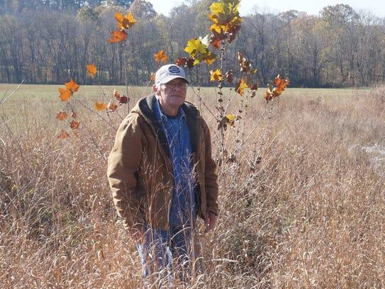 Frank Metcalf in his hay field.