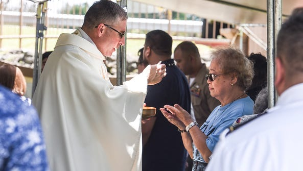 Communion is served to former residents of Sumay village,