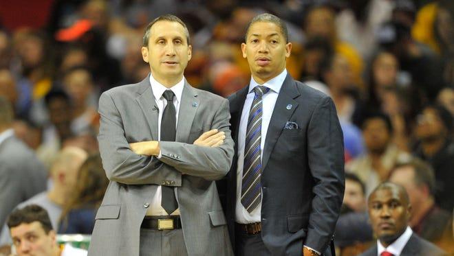 Former Cleveland Cavaliers head coach David Blatt, left, talks with assistant Tyronn Lue.