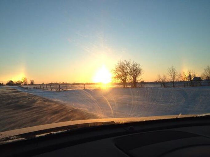 "Readers are sharing their photos of ""sun dogs,"" or bright spots of light that appear on the horizon, with Paul Poteet. Tammy Middleton of Lebanon tweeted this photo."