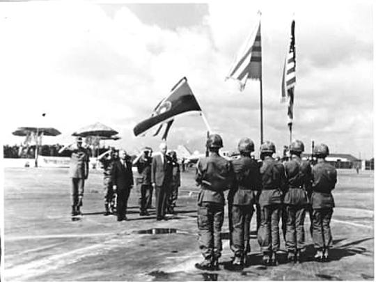 Petersen, far left, facing Color Guard, as he is about to leave Vietnam in 1969.