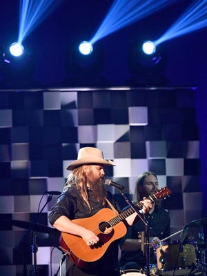 Chris Stapleton performs during the CMA Awards on Nov. 8, 2017, at Bridgestone Arena in Nashville. He won awards for album and male vocalist of the year.