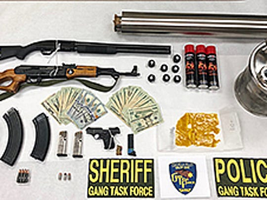 Guns and cash were recovered during a June 29 investigation