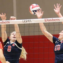 Brookfield East's Emma Kiekhofer (8) and Taylor Allen (10) attempt a block on DSHA's Katie Rolfe during the Spartans' 3-0 win over the Dashers on Sept. 27.
