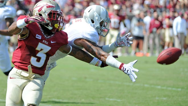 Maryland wide receiver Deon Long (6) is unable to catch a pass against Florida State defensive back Ronald Darby during a 2013 game.