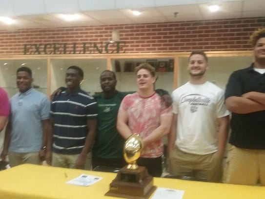 Northwest coach Vernon Wright (center) stands with