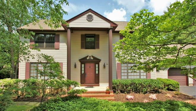 This four-bedroom Colonial has an updated kitchen and a resort-like backyard with a pool.