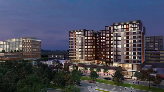 A rendering of the proposed 12-story apartment building on the 100 block of East Grand River Avenue in East Lansing.