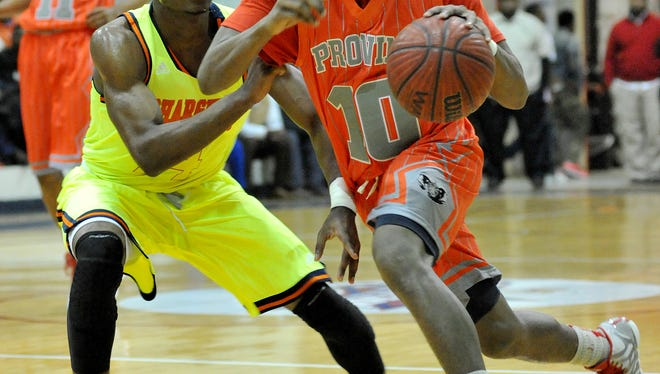 Provine's D'Angelo West pushes past Callaway's Malik Newman during their game Tuesday at Forest Hill High School in Jackson.