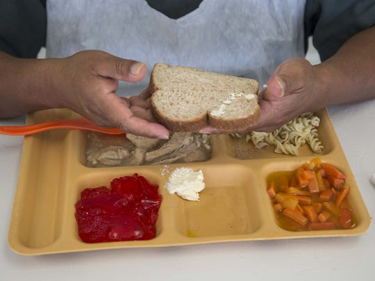 A detainee eats lunch at the Eloy Detention Center