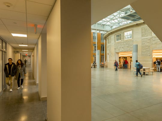 A corridor that separates small class spaces at the east side of Klarman Hall is partially open to the atrium.