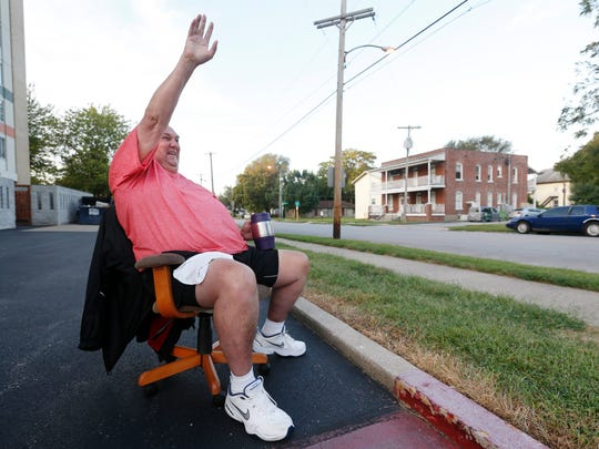 Martin Gotthardt waves to a car as it passes by South Avenue Tower on Thursday, August 25, 2016. Gotthardt has spent most of his mornings waving to pedestrians, bikers and drivers on South Avenue for the past 6 years.