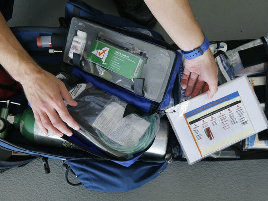 A epinephrine injection kit with instructions that