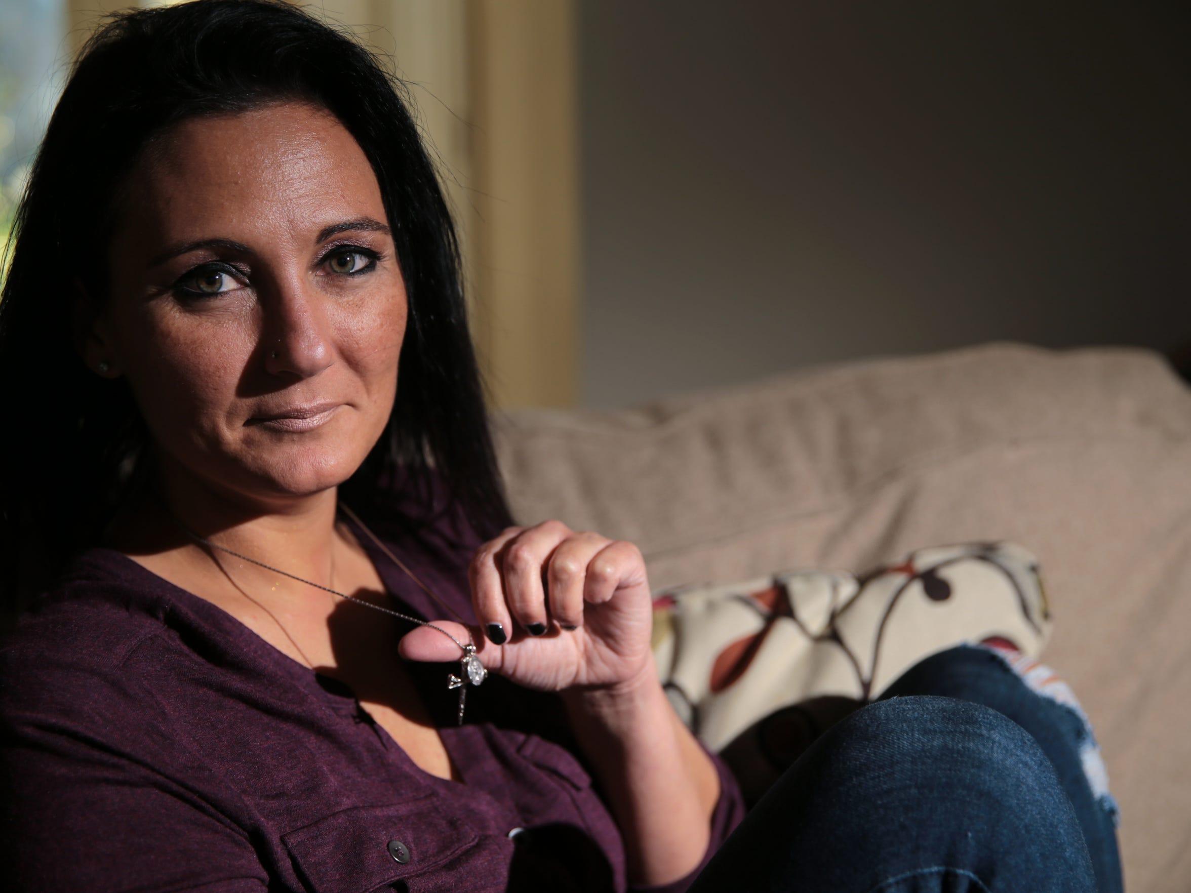 Christine Shamoon, Jacob Faulkner's girlfriend, holds