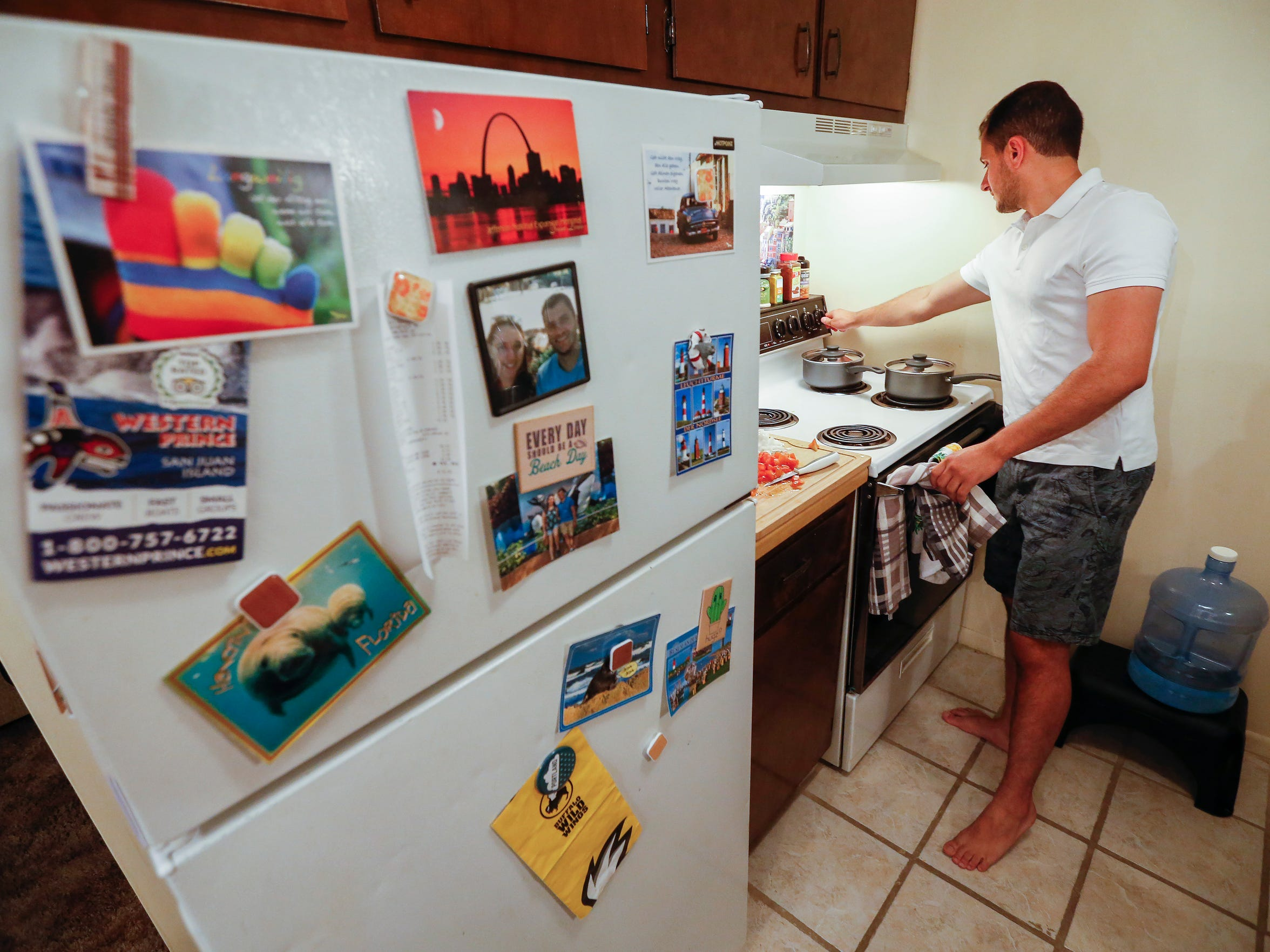Mohammed Jubary cooks dinner in his apartment on Tuesday,