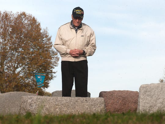 Vincent Lobascio stands in front of the grave of fallen soldier Anthony Ferri, both, originally from the same Camden neighborhood.