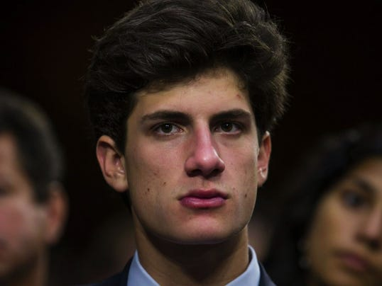 John Kennedy Schlossberg watches his mother, Caroline Kennedy, testify before the Senate Foreign Relations Committee to be the new US Ambassador to Japan in the Hart Senate Office Building in Washington, DC,