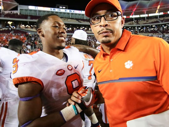 Clemson running back Wayne Gallman (9) and running backs coach Tony Elliott celebrate after the game at Florida State.