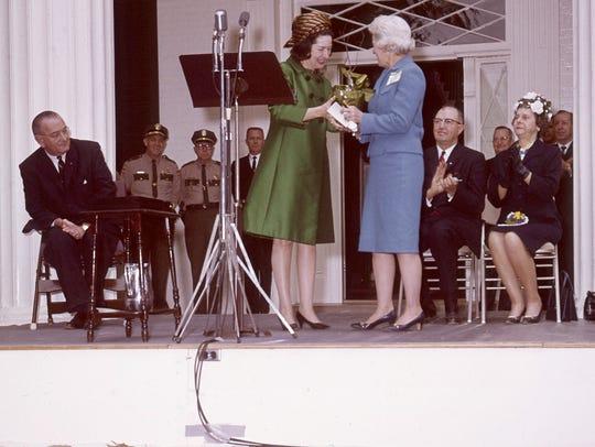 President Lyndon B. Johnson, left, watches his wife,