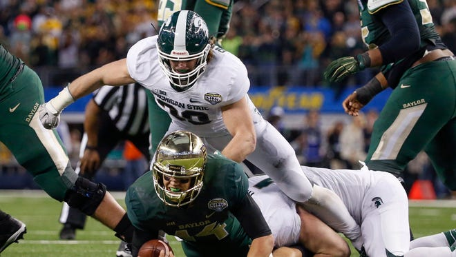 Michigan State Spartans linebacker Riley Bullough  sacks Baylor Bears quarterback Bryce Petty during the fourth quarter in the 2015 Cotton Bowl Classic at AT&T Stadium on Jan. 1, 2015.