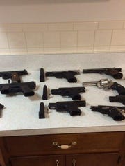 Guns seized in a 2014 police raid in Port Chester. A new report by the state Attorney General determined that 76% of seized 'crime guns' in Westchester, Rockland and Putnam counties come from out of state.