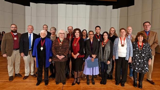 New Mexico State University faculty, administrative and community engagement award winners pose for a group photo following the 2017 spring Convocation ceremony, on Jan. 17, 2017, at the Atkinson Recital Hall. Awardees include, left to right, Michael Hout, Michael Johnson, Barbara Hubbard, Vicente Lombraña, Nancy McMillan, Kenda Josselet, Jeff Longwell, Merranda Marín, Susan DeMar, Satya Rao, Fangjun Shu, Anna López, Kelcie Gerry, Karen Henry, Mike Teitsworth, María Ortiz and Matthew Holt.