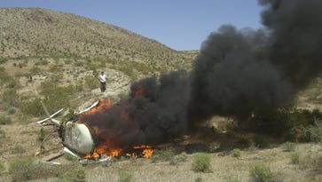 David Wallace was piloting this Robinson helicopter that was videotaping a desert off-road race when he crashed.