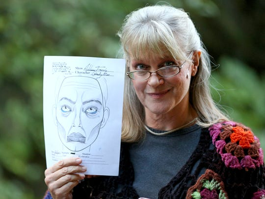 "Carol Pavelek will portray Grandma Addams in Pentacle Theatre's ""The Addams Family."" She holds a makeup template by makeup designer Isaac Joyce-Shaw."