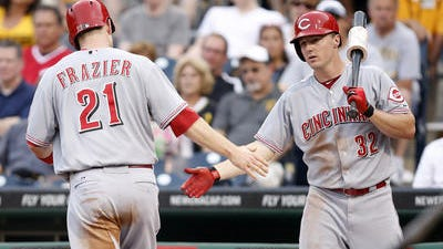 Todd Frazier is congratulated by Jay Bruce after scoring a run Wednesday against the Pirates at PNC Park in Pittsburgh. Frazier's first-half numbers are All-Star-worthy, but the nation hasn't caught on yet.